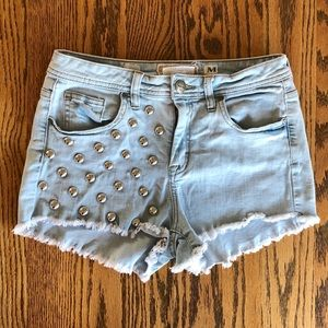 High-waisted studded shorts